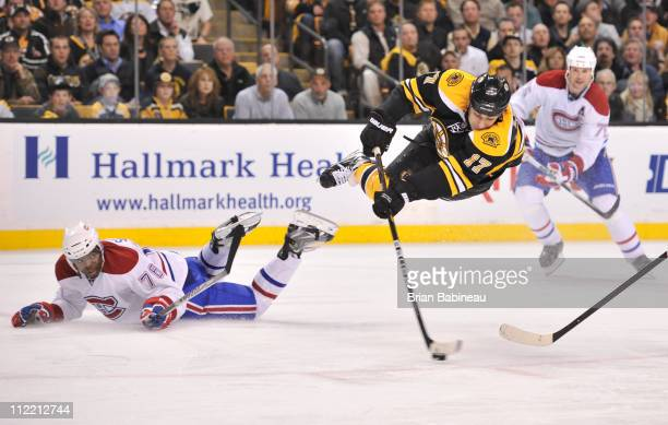 Milan Lucic of the Boston Bruins shoots the puck against the Montreal Canadiens in Game One of the Eastern Conference Quarterfinals during the 2011...