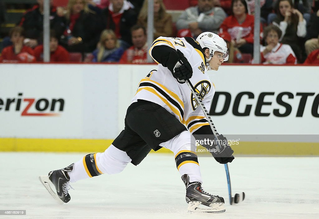Milan Lucic #17 of the Boston Bruins shoots the puck during the third period against the Detroit Red Wings during Game Three of the First Round of the 2014 NHL Stanley Cup Playoffs at Joe Louis Arena on April 22, 2014 in Detroit, Michigan. The Bruins defeated the Wings 3-0.