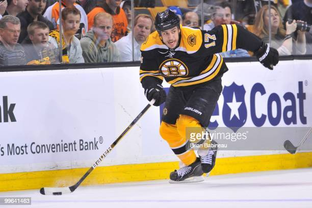 Milan Lucic of the Boston Bruins skates up the ice with the puck against the Philadelphia Flyers in Game Seven of the Eastern Conference Semifinals...