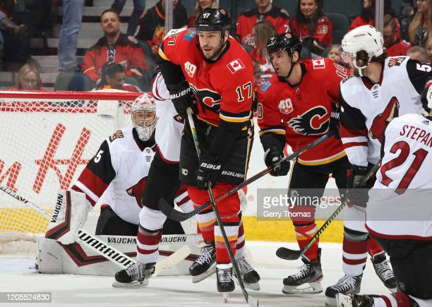 Milan Lucic of the Calgary Flames battles in front against the Arizona Coyotes at Scotiabank Saddledome on March 6 2020 in Calgary Alberta Canada