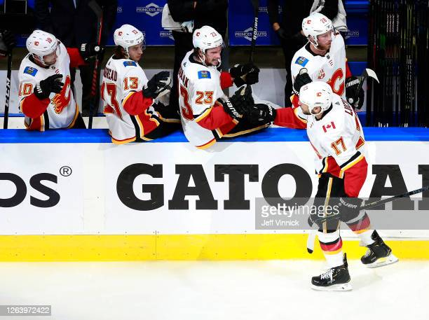 Milan Lucic of the Calgary Flames celebrates his goal with teammates on the bench in the third period against the Winnipeg Jets in Game Three of the...