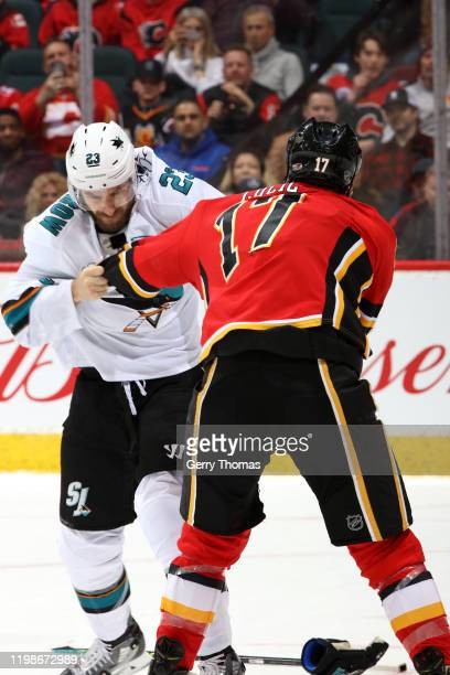 Milan Lucic of the Calgary Flames fights Barclay Goodrow of the San Jose Sharks at Scotiabank Saddledome on February 04 2020 in Calgary Canada