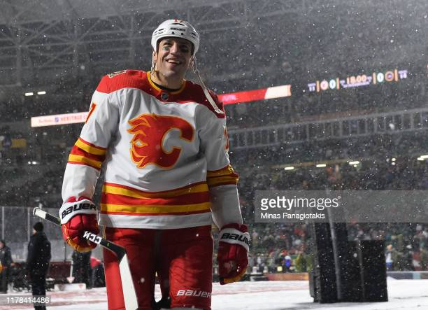 Milan Lucic of the Calgary Flames leaves the ice at the end of the first period against the Winnipeg Jets during the 2019 Tim Hortons NHL Heritage...