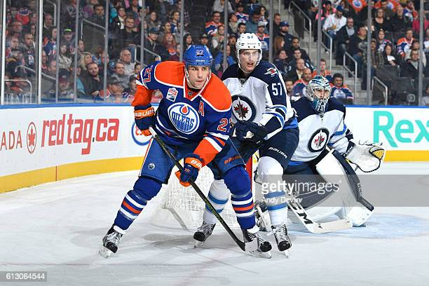 Milan Lucic of the Edmonton Oilers battles for position against Tyler Myers of the Winnipeg Jets on October 6 2016 at Rogers Place in Edmonton...