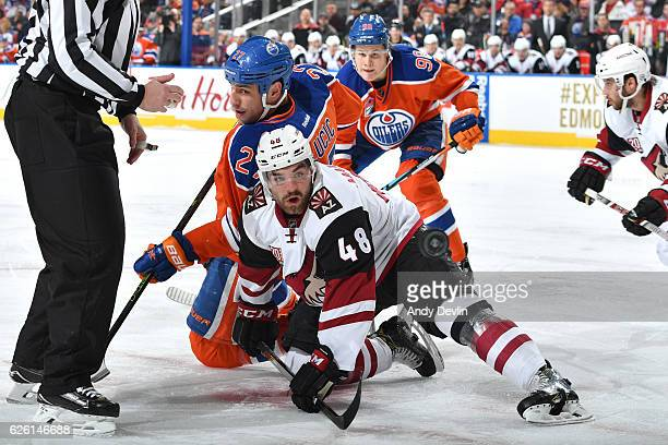 Milan Lucic of the Edmonton Oilers battles for the puck against Jordan Martinook of the Arizona Coyotes on November 27 2016 at Rogers Place in...