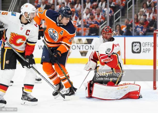 Milan Lucic of the Edmonton Oilers can't get past goaltender Mike Smith of the Calgary Flames at Rogers Place on October 4 2017 in Edmonton Canada