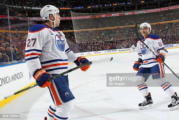 Milan Lucic of the Edmonton Oilers celebrates his second period goal against the Buffalo Sabres with teammate Matthew Benning during an NHL game at...