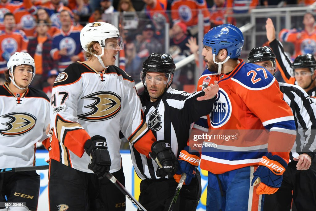 Milan Lucic #27 of the Edmonton Oilers exchanges words with Hampus Lindholm #47 of the Anaheim Ducks in Game Six of the Western Conference Second Round during the 2017 NHL Stanley Cup Playoffs on MAY 7, 2017 at Rogers Place in Edmonton, Alberta, Canada.