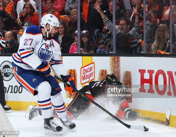 Milan Lucic of the Edmonton Oilers gains control of the puck against Ryan Getzlaf of the Anaheim Ducks in Game Five of the Western Conference Second...