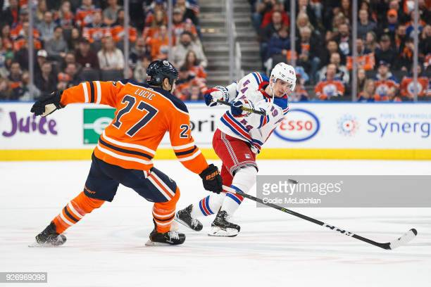Milan Lucic of the Edmonton Oilers skates against Pavel Buchnevich of the New York Rangers at Rogers Place on March 3 2018 in Edmonton Canada
