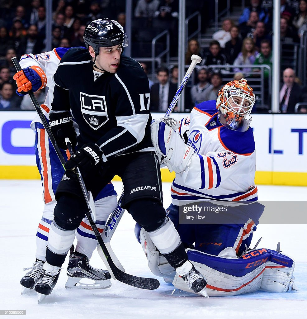 Milan Lucic #17 of the Los Angeles Kings and Cam Talbot #33 of the Edmonton Oilers look for a rebound with Jordan Oesterle #82 during the second period at Staples Center on February 25, 2016 in Los Angeles, California.