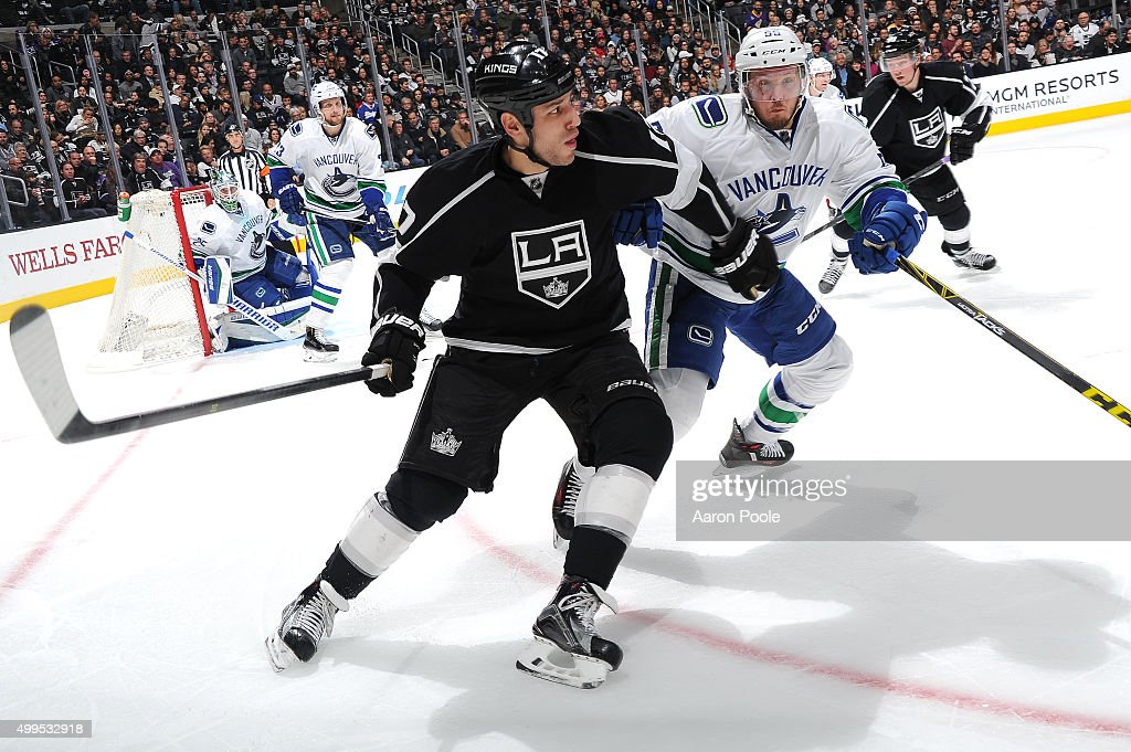 Milan Lucic #17 of the Los Angeles Kings battles for the puck against Alex Biega #55 of the Vancouver Canucks at STAPLES Center on December 01, 2015 in Los Angeles, California.