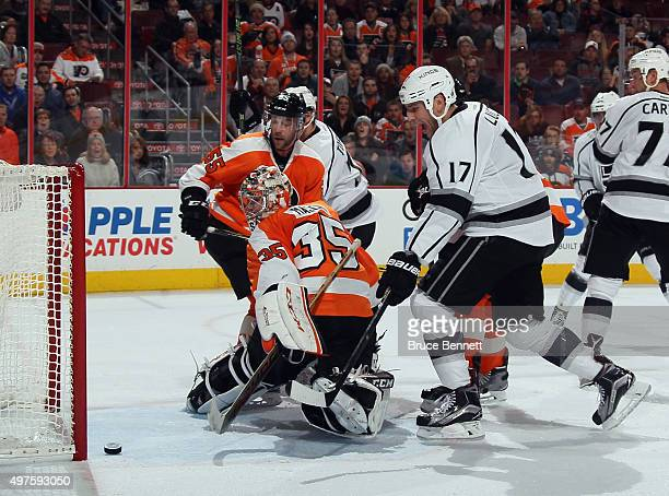 Milan Lucic of the Los Angeles Kings scores against Steve Mason of the Philadelphia Flyers at 1904 of the third period to tie the score at 22 at the...