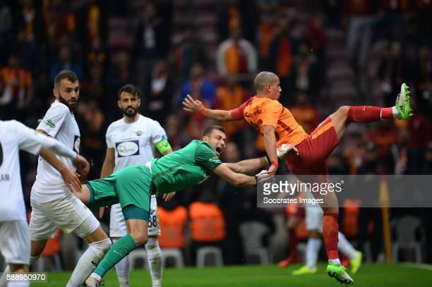 Milan Lukac of Akhisar Belediyespor Sofiane Feghouli of Galatasaray during the Turkish Super lig match between Galatasaray v Akhisar Belediyespor at...