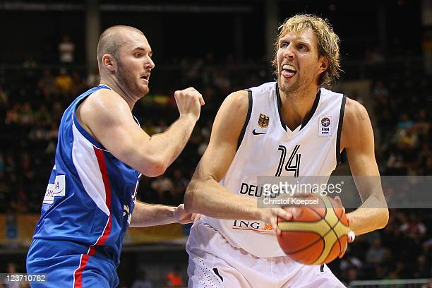 Milan Macvan of Serbia defends against Dirk Nowitzki of Germany during the EuroBasket 2011 first round group B match between Germany and Serbia at...