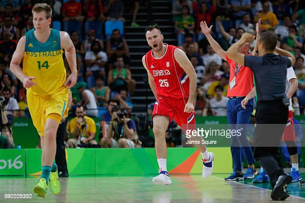 Milan Macvan of Serbia reacts after scoring against Australia during the Men's Semifinal match on Day 14 of the Rio 2016 Olympic Games at Carioca...