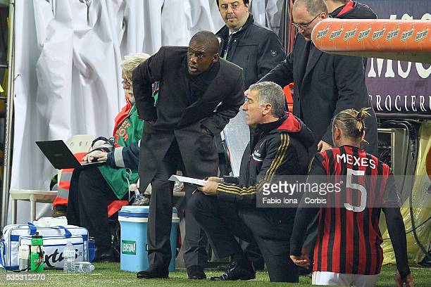AC Milan manager Clarence Seedorf talks with Mauro Tassotti during the TIM Cup match between AC Milan and Udinese Calcio at Stadio Giuseppe Meazza on...