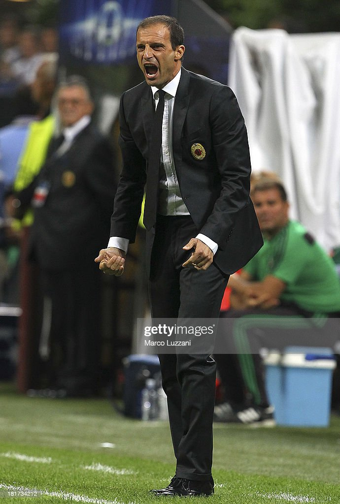 AC Milan manager Massimiliano Allegri shouts to his players during the UEFA Champions League group H match between AC Milan and Celtic at Stadio Giuseppe Meazza on September 18, 2013 in Milan, Italy.