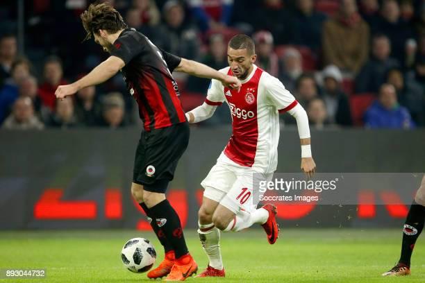Milan Massop of Excelsior Hakim Ziyech of Ajax during the Dutch Eredivisie match between Ajax v Excelsior at the Johan Cruijff Arena on December 14...