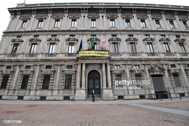 Milan mayor Giuseppe Sala stands at attention outside the city hall during a minute of silence at noon on March 31 2020 in Milan as flags are being...
