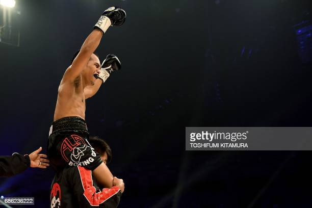 Milan Melindo of the Philippines celebrates after beating Akira Yaegashi of Japan in their IBF junior flyweight title boxing bout in Tokyo on May 21,...