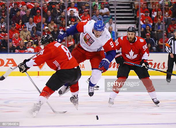 Milan Michalek of Team Czech Republic is trippd up by Drew Doughty of Team Canada during the second period during the World Cup of Hockey tournament...