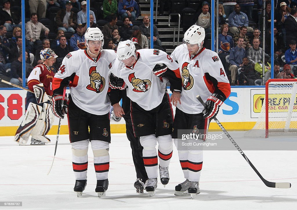 Milan Michalek #9 of the Ottawa Senators is helped off the ice after being injured against the Atlanta Thrashers at Philips Arena on March 18, 2010 in Atlanta, Georgia.