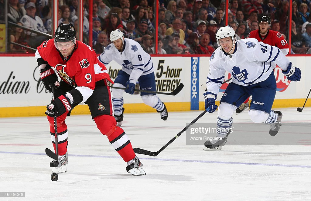 Milan Michalek #9 of the Ottawa Senators skates in with the puck on a breakaway against Nikolai Kulemin #41 of the Toronto Maple Leafs at Canadian Tire Centre on April 12, 2014 in Ottawa, Ontario, Canada.