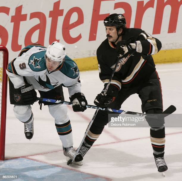 Milan Michalek of the San Jose Sharks defends against George Parros of the Anaheim Ducks during Game Four of the Western Conference Quarterfinal...