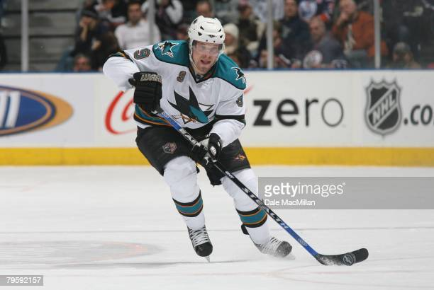 Milan Michalek of the San Jose Sharks skates with the puck against the Edmonton Oilers during their NHL game on January 29 2008 in Edmonton Alberta...