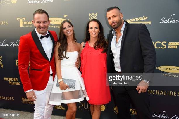 Milan Michalides and his wife Emanuela Michalides Tim Wiese and his wife Grit Wiese attend the 'Michalides Zahn Werder Klinik' Opening on August 23...