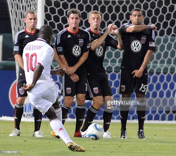 AC Milan midfielder Clarence Seedorf takes a free kick against the DC United defensive wall during secondhalf action in a soccer friendly at RFK...