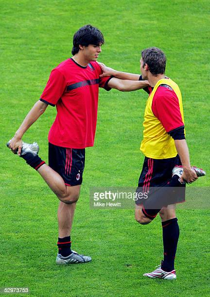 Milan Midfielder Kaka of Brazil stretches next to AC Milan Striker Andriy Shevchenko of Ukraine during a training session ahead of the European...