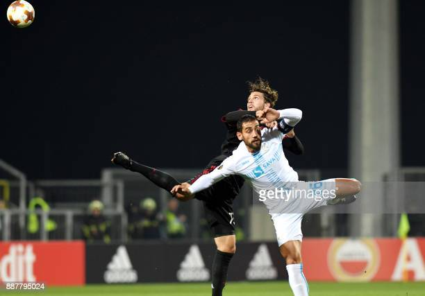 AC Milan midfielder Manuel Locatelli vies with Rijeka's midfielder Mate Males during the UEFA Europa League Group D football match between HNK Rijeka...