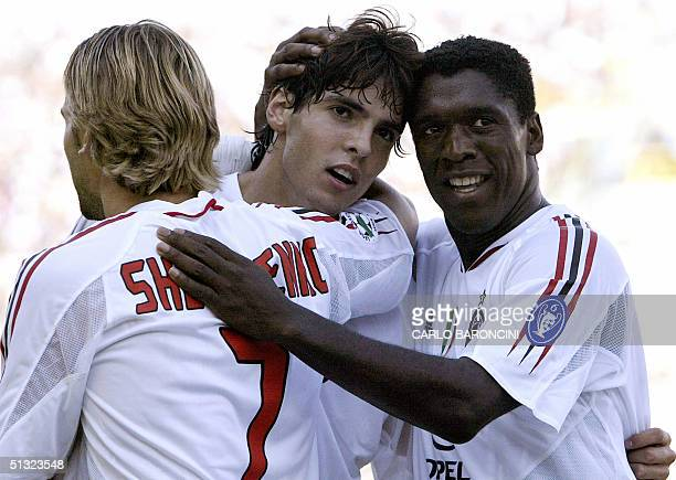 Milan midfielder Ricardo Leite Kaka is embraced by teammates midfielder Dutch Clarence Seedorf and Ukrainian forward Andriy Shevchenko after scoring...