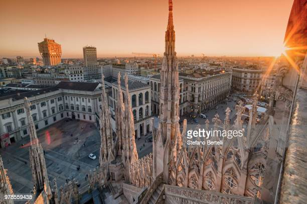 milan old town square at sunset seen from milan cathedral, milan, lombardy, italy - milán fotografías e imágenes de stock
