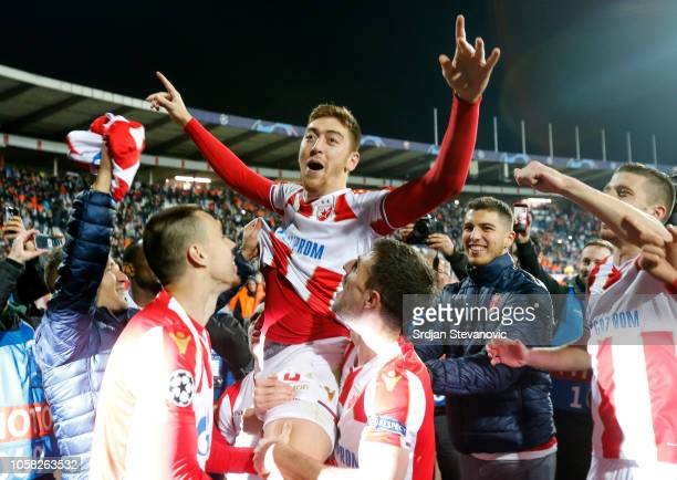 Milan Pavkov of Crvena Zvezda celebrates victory with team mates after the Group C match of the UEFA Champions League between Red Star Belgrade and...