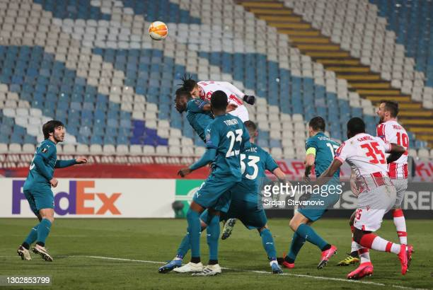 Milan Pavkov of Crvena Zvezda scores their sides second goal during the UEFA Europa League Round of 32 match between Crvena Zvezda and AC Milan at...