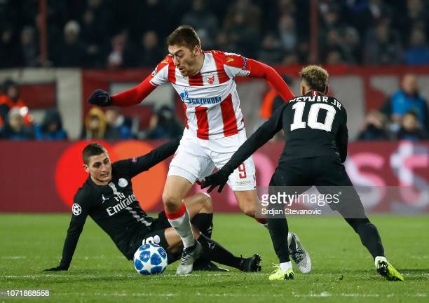 Milan Pavkov of Red Star Belgrade in action against Marco Verratti and Neymar of Paris SaintGermain during the UEFA Champions League Group C match...