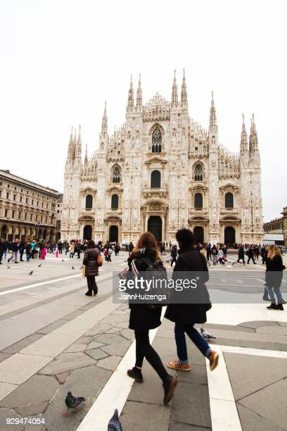 milan: piazza del duomo and cathedral and people - duomo di milano stock pictures, royalty-free photos & images