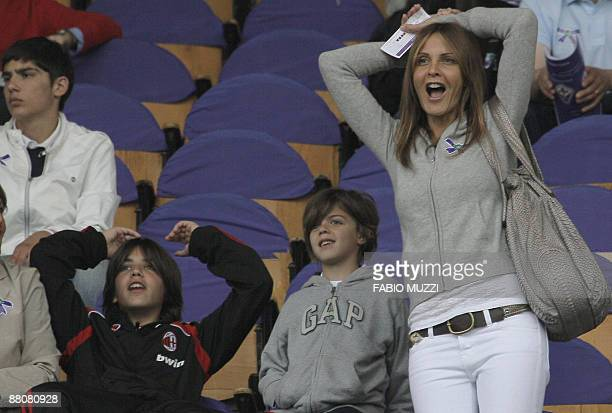 Milan player Paolo Maldini's wife Adriana Fossa together with their children are pictured at the Artemio Franchi stadium prior to the Italian Serie A...