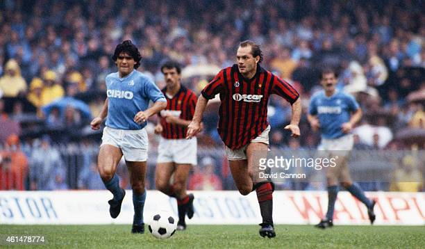 Milan player Ray Wilkins pulls away from Diego Maradona of Napoli during an Italian League match in 1984 in Naples Italy