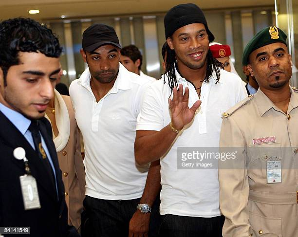 Milan Player Ronaldinho is escorted by security after arriving at Dubai International Airport on December 30 2008 in Dubai United Arab Emirates