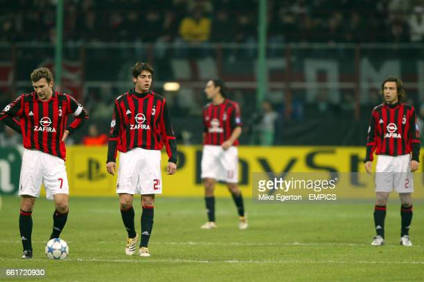 AC Milan players Andriy Shevchenko and Kaka stand dejected after conceeding a goal
