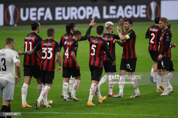 Milan players celebrate after Brahim Diaz scored to give the side a 10 lead during the UEFA Europa League Group H stage match between AC Milan and AC...