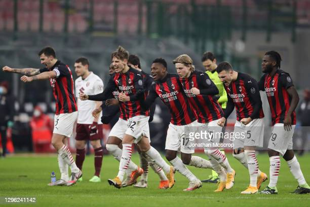 Milan players celebrate as Hakan Calhanoglu scores the winning penalty in the shoot out during the Coppa Italia match between AC Milan and Torino FC...