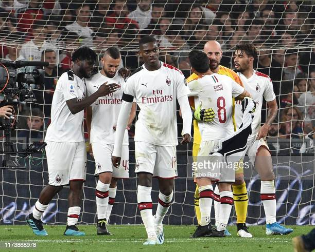 Milan players celebrate at the end of the Serie A match between Genoa CFC and AC Milan at Stadio Luigi Ferraris on October 5 2019 in Genoa Italy