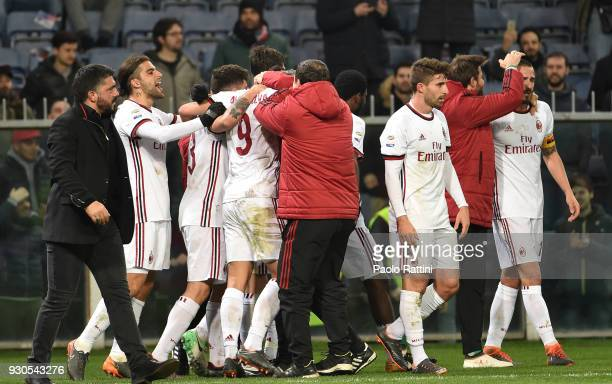 Milan players celebrate at the end of the serie A match between Genoa CFC and AC Milan at Stadio Luigi Ferraris on March 11 2018 in Genoa Italy
