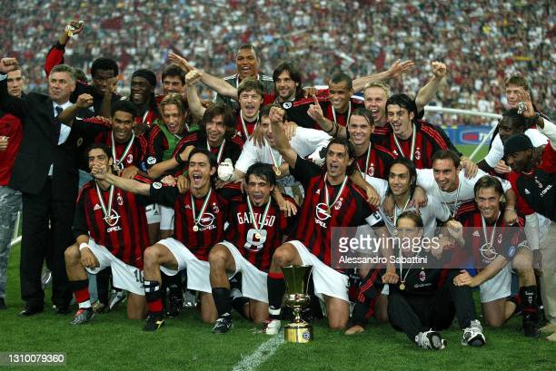Milan players celebrate the victory with the trophy after the Finale Coppa Italia match between As Roma and AC Milan at Stadio Olimpico on 20 May...