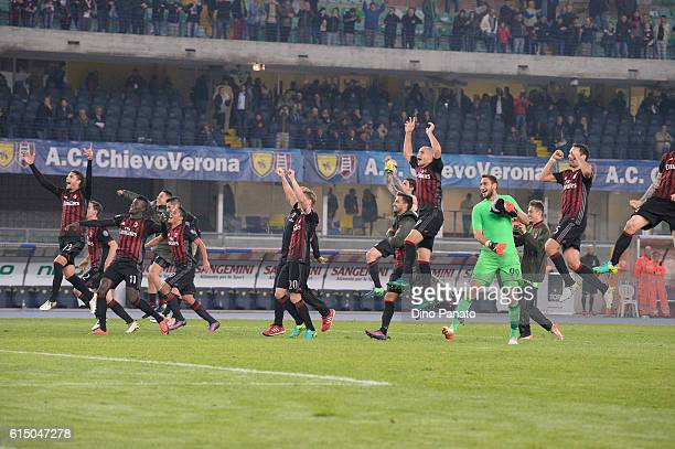 Milan players celebrate victory after the Serie A match between AC ChievoVerona and AC Milan at Stadio Marc'Antonio Bentegodi on October 16 2016 in...